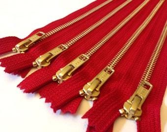 Wholesale metal teeth zippers - Ten red 9 inch brass zippers - YKK color 519