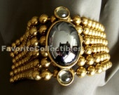 OOAK Shoulder Pin Brooch Epaulet Dangles 80s Brass Ball Chains Vamp Vintage from FavoriteCollectibles