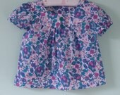 Pretty flowery top to suit a 4 year old little girl.  25 dollars