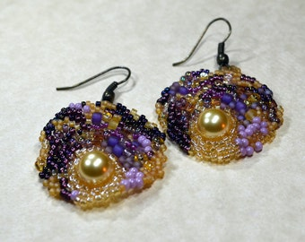 Freeform peyote seed beaded earrings in purple and gold.  Art jewelry. Wedding, special occasion, prom