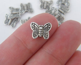 18 Butterfly spacer beads antique silver tone A338