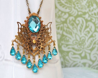 THE BLUE PEACOCK - Art Deco style vintage brass fligree pendant with auqa blue jewels and glass cab
