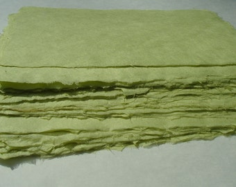 Eight sheets of 8 x 10 inch pale avocado abaca kozo paper