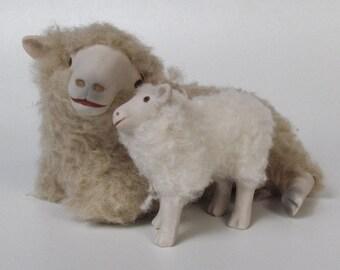 Romney Ewe Lying Cheek to Cheek with Standing Lamb
