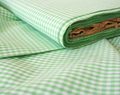 Yardage of vintage cotton fabric in gingham pattern. Green, white, checker, spring, sewing.