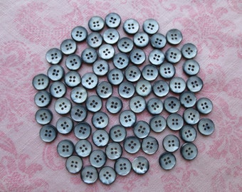 Vintage beautiful small silver gray color faux mother of pearl round plastic buttons. Wholesale lot of 85.