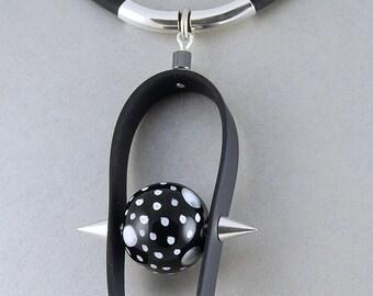 Contemporary Ceramic  Bead Pendant on  Rubber Cord.