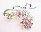flower bouquet brooch rhinestones and green enamel ribbon with pink flowers