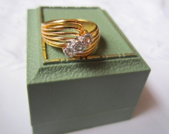 Vintage Gold Tone Ring with Six-Wire Setting and Three Faceted Clear Rhinestones