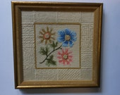 Vintage needlepoint, stylized flowers,stitchery sampler on border, custom framed, 13 1/2inches square.
