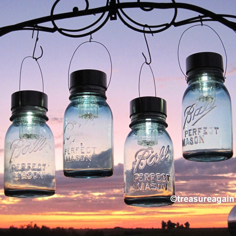 Hanging mason jar lights 4 ball mason jar solar lights for Hanging lights made from mason jars