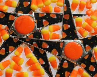 Candy Corn Star- 9 inches lacquered fabric on glass with stained glass cabochon