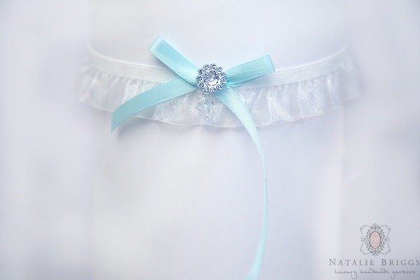 A wedding garter something blue bow garter by nataliebriggs for Garter under wedding dress