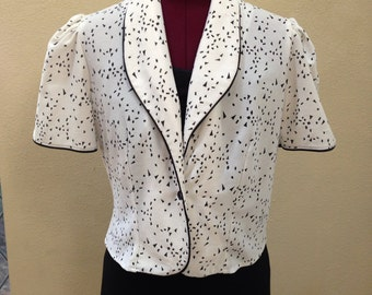 Vintage white jacket with black pipping and specs