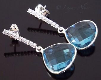 Shiny white gold/silver and London blue teardrop earrings