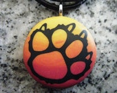 Wolf print hand carved on a polymer clay red orange and yellow color background. Pendant comes with a FREE 3mm necklace
