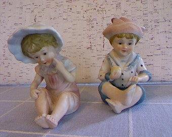 Bisque Boy And Girl Figurines