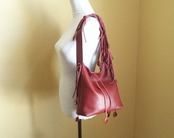 wine red leather handbag, shoulder purse, with leaf fringe, by Tuscada. Made to order.