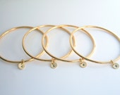 RESERVED - 6 separate initial gold charms on one gold bangle