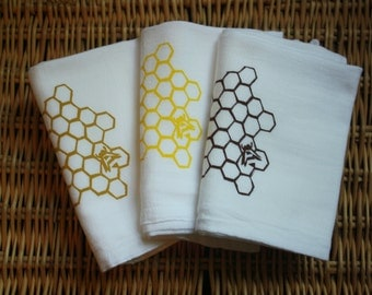 Honeycomb with honey bee kitchen towels.  Set of three in golden, yellow and brown
