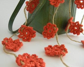 Crochet flower garland in earthy orange color