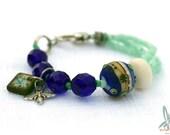 Blue green bracelet, cobalt blue, sea green, lampwork glass bead, Czech glass, wooden art tile charm, bohemian bracelet by Esfera Jewelry