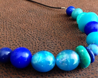 Blue green beaded pendant necklace