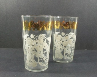2 Mid-Century White & Gold Glasses