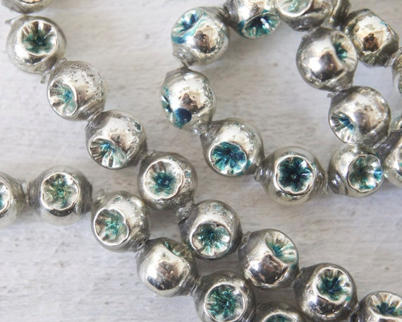 Vintage mercury glass garland silver and turquoise indent
