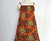African Print girl's dress in a bright orange and yellow flower pattern