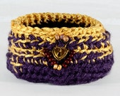 Fiber Art Basket- crocheted purple wool and gold rayon yarn.  Embellished with gold locket and beads.