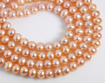 20 pcs: 6mm off round freshwater pearls, grade AA+, natural light pink color