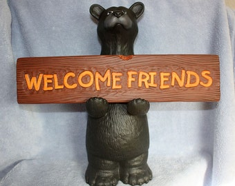 Handpainted ceramic Doc Holiday Black Bear holding a Welcome Friends Sign