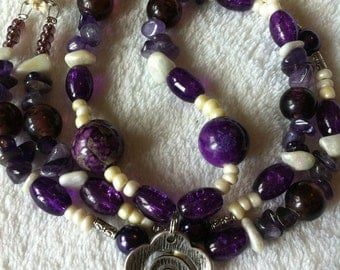 White and purple necklace with flower pendant
