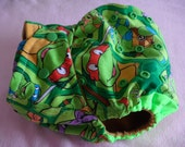 SassyCloth one size pocket diaper with Ninja Turtles cotton print. Made to order.