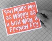 You make me as happy as a bird with a french fry - Orange with white lettering Card- blank inside