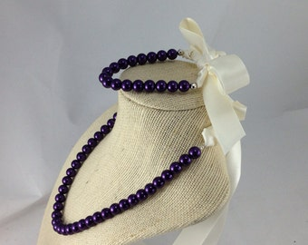 Purple junior bridesmaid or flower girl beaded necklace with ribbon closure