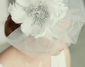 Royal crystal and feather fascinator.  Vintage style bridal veil. Huge exquisite wedding fascinator. White feather and crystal fascinator