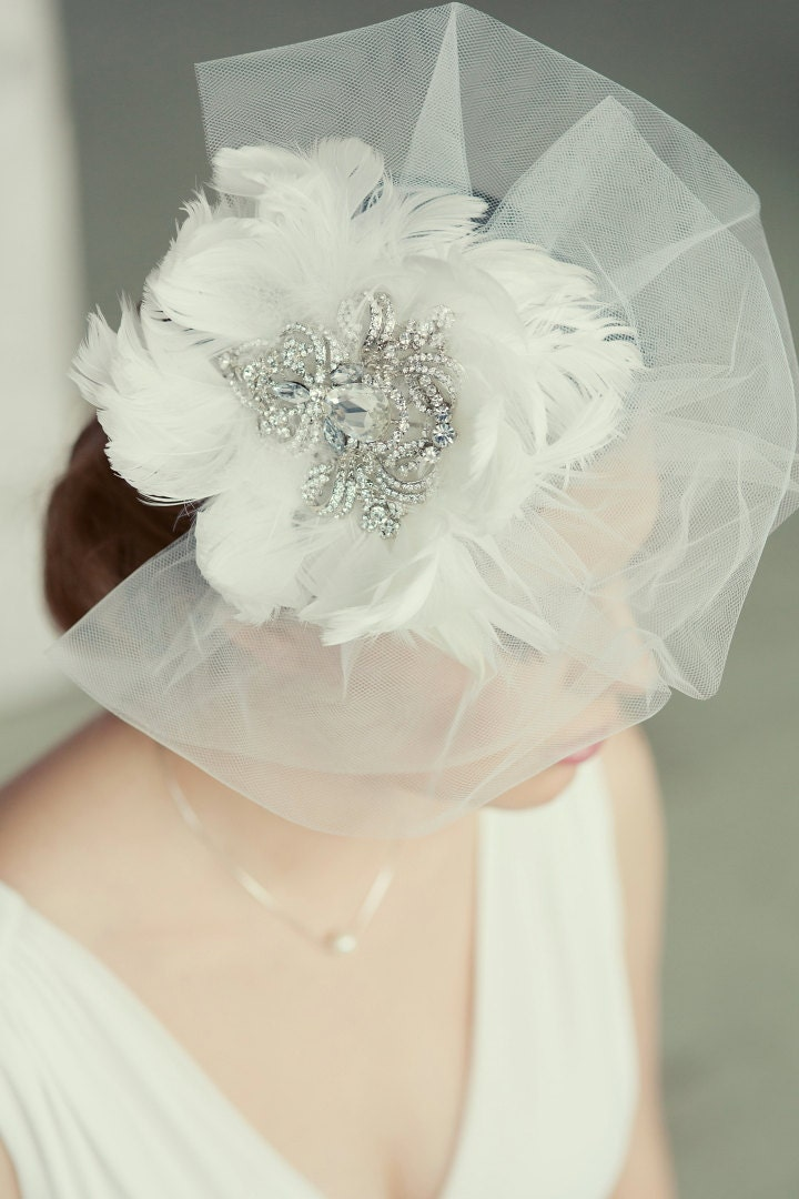 Royal crystal and feather fascinator. Vintage style bridal