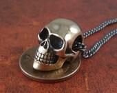 "Small Skull Necklace - Bronze Small Human Skull on 24"" Gunmetal Chain"