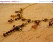50% off ALL MST GO Swarovski Crystal Cross Necklace, Amber & Bronze