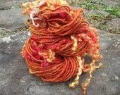 Tangerine dream handspun tailspun art yarn 72 yds
