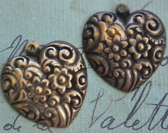 TWO Victorian  brass heart charms with flowers, natural discoloration