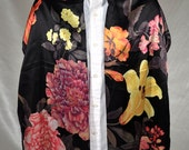 Metropolitan Museum of Art oblong scarf. Black with a multicolored rich floral design