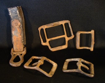 Old horse harness parts buckles rusty metal