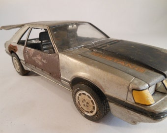 Late eighties Ford Mustang 1/24 scale model car in silver and rust