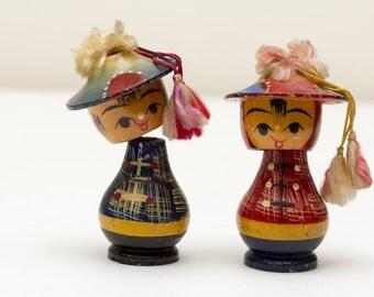 Asian Wooden Bobble Head Couple
