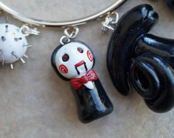 Saw's Jigsaw Puppet Inspired Pawn Charm