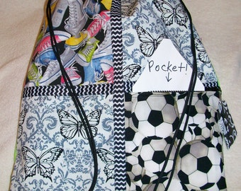 tennis shoes and soccer balls on a lime green drawstring backpack with front zipper pocket