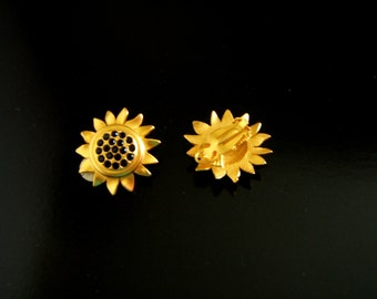 Signed Karl  Lagerfeld Matte Goldtone Black Rhinesoines Floral  Style Earrings clip on